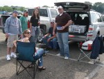 Friends gather to do some tailgaiting in the Midway Stadium parking lot before a St. Paul Saints game.